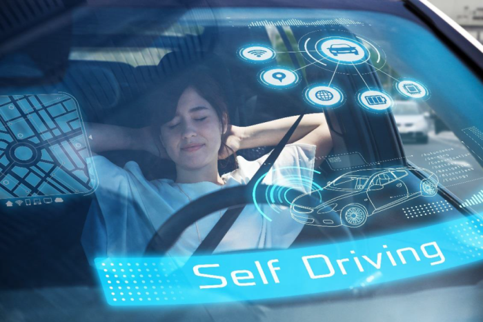 Woman resting in a self driving vehicle